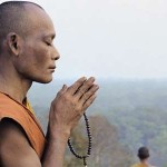 Buddhist In Prayer
